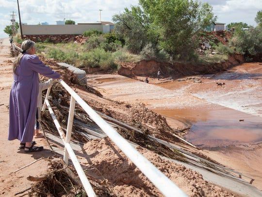 Residents of Short Creek observe damage and debris