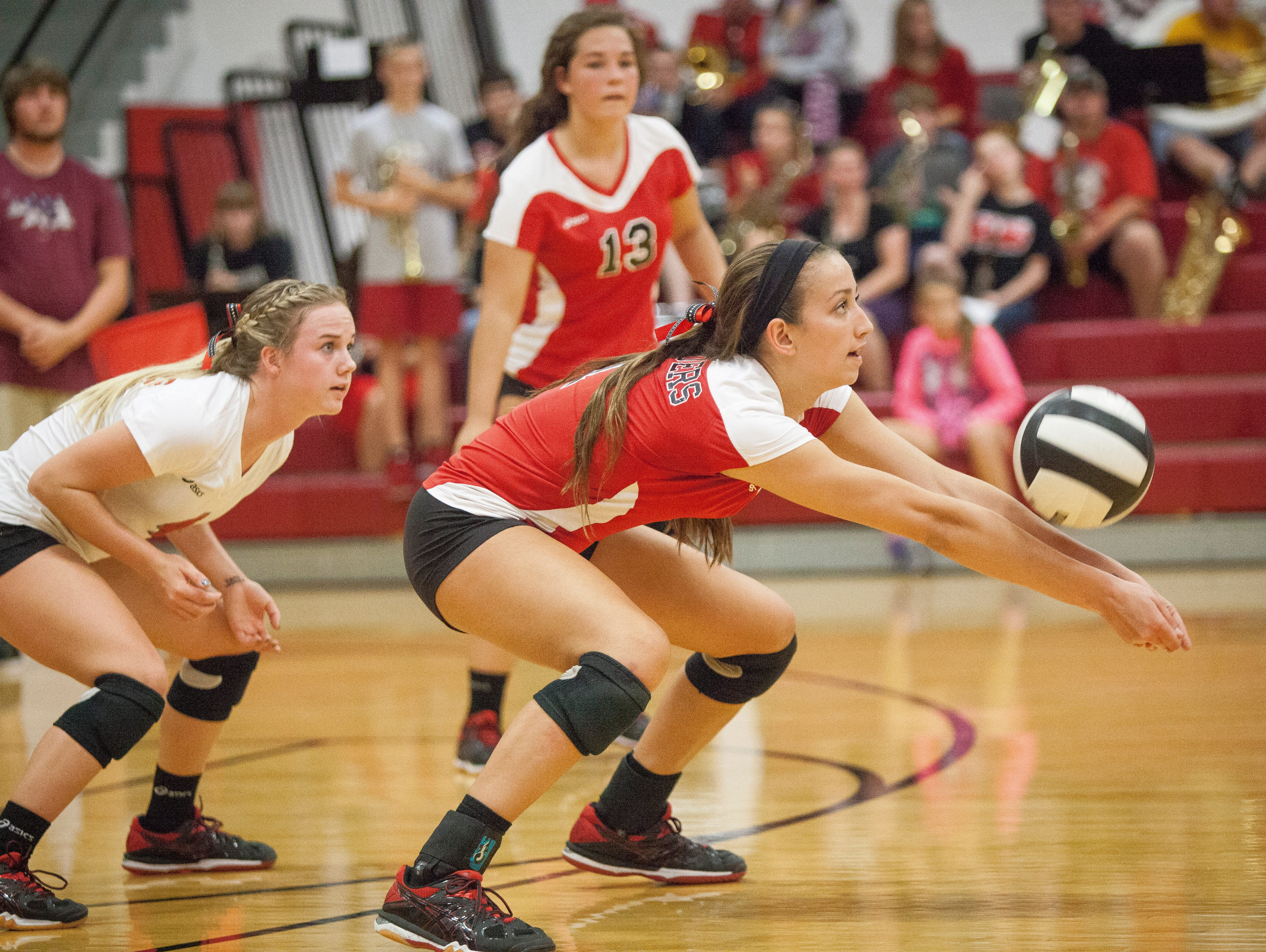 Skyler VanNote the middle blocker for Wapahani returns the serve from Central on Monday at Wapahani High School. Central won 3-0.