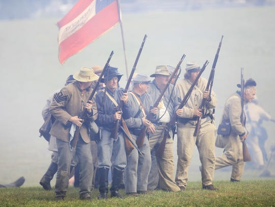 The last of the Confederate troops reform their lines