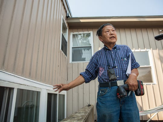 Burlington landlord Soon Kwon shows the Free Press a code violation he disagreed with last year.