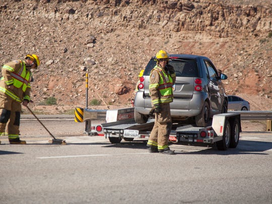 Utah Highway Patrol troopers and paramedics from Gold