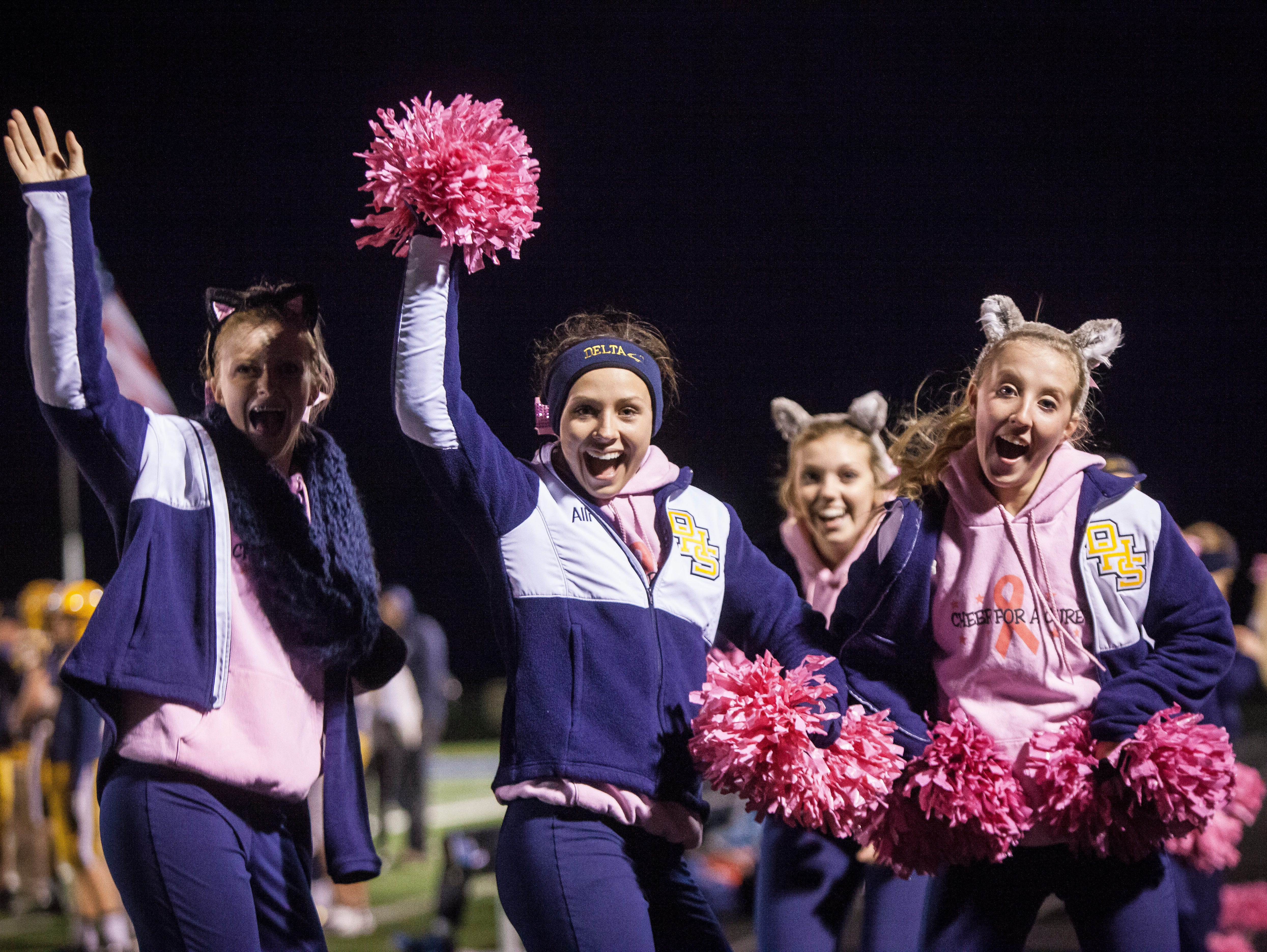 Delta cheerleaders keep the energy high at the sectional game Friday night despite a one sided game. Delta won 49-7.