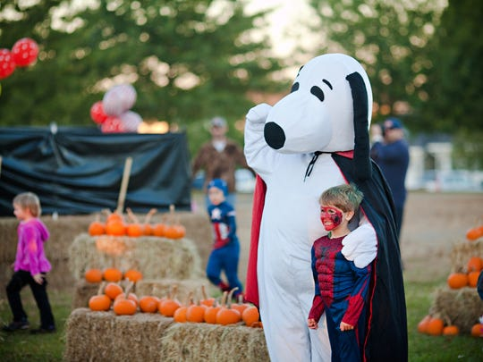 Snoopy and Spiderman pose during the annual Halloween