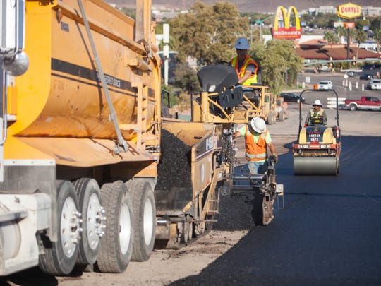 Road construction crews work on Black Ridge Drive Thursday, Nov. 11, 2015. New construction has helped add new jobs to the Utah economy over the past 12 months, according to a new report from the Department of Workforce Services.