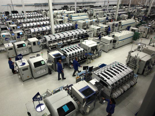 Employees work in the EA Manufacturing ESD Control Area at Gentex Corporation in Zeeland on Thursday, Sept. 29, 2011.