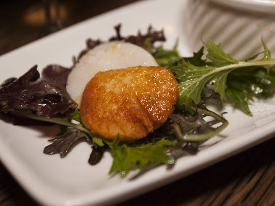 Seared sea scallops and Pitchfork Farm greens with