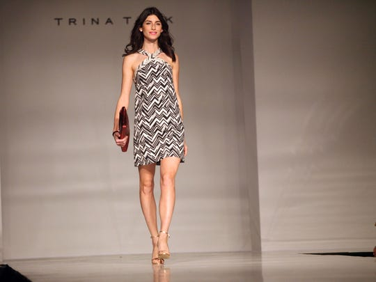 Designer Trina Turk's clothes are modeled at the 56th annual St. Theresa School Holiday Fashion Show on Tuesday at the Agua Caliente Resort and Spa in Rancho Mirage.