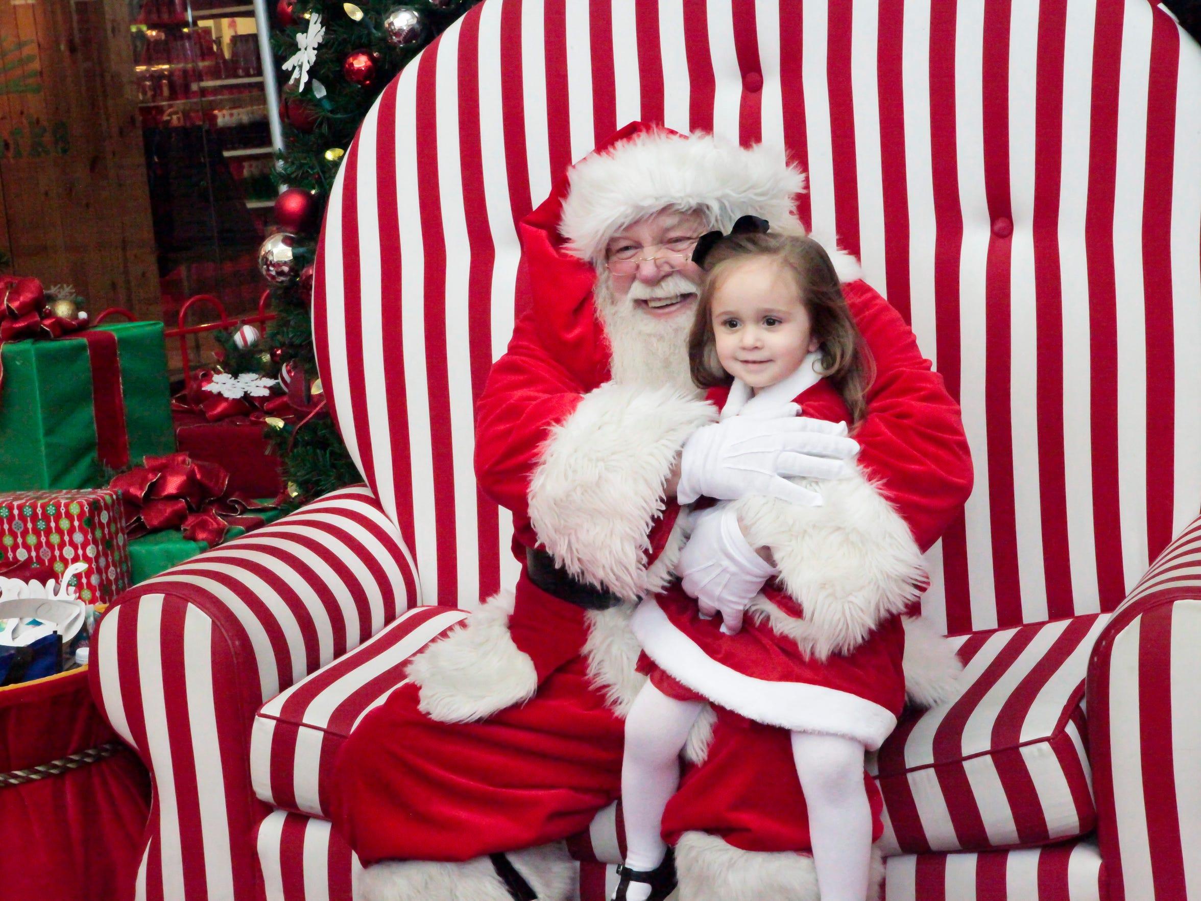 Santa hugs Ava Walters.