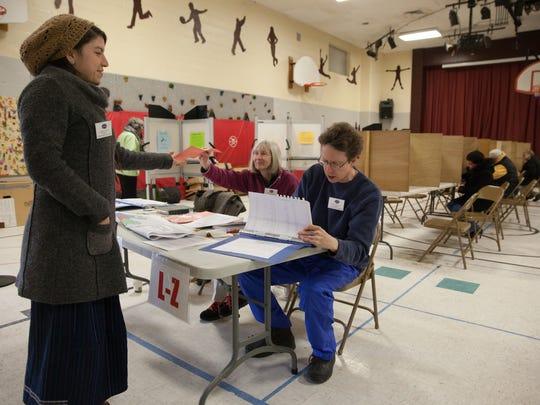 City Council candidate for ward 2, Carmen Solari, takes a ballot at H.O. Wheeler School, in a previous election.