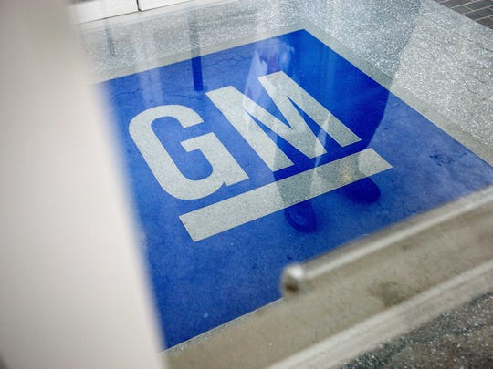 In this file photo, the logo for General Motors decorates the entrance at the site of a GM information technology center.