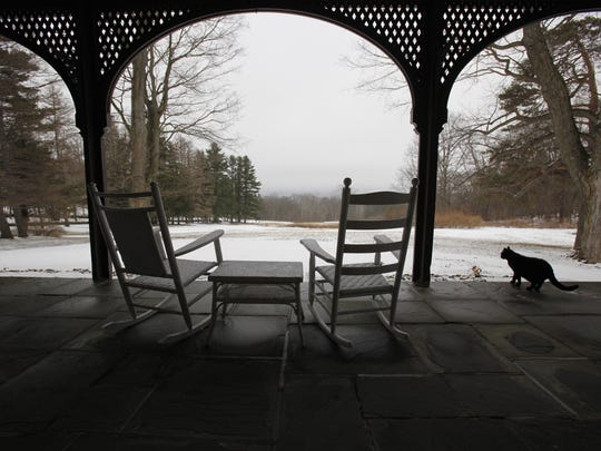 A black cat wanders on the front porch of Quarry Farm and the original site of the Mark Twain Study in 2010.