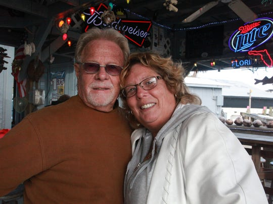 "San Carlos Island realtor Kathy Young gets a hug from friend ""Kase Smith"" Saturday at Bonita Bill's, a beloved island watering hole. Young, who used to work at the cafe-bar, is bullish on the proposed Bay Harbour Marina Village because it will increase property values."