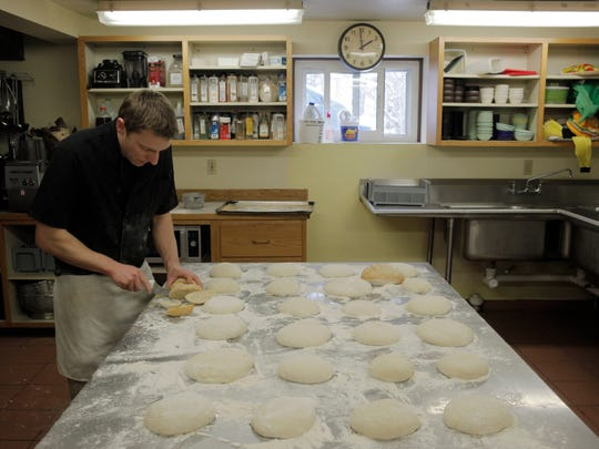 Chef Paul Pellegrino tends to bread prepared by students from Newbury Elementary School.