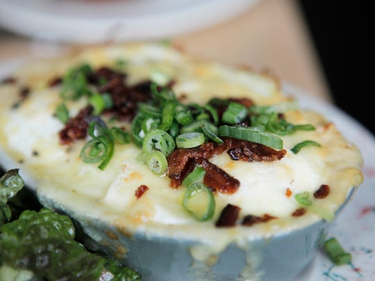 Butch + Babe's restaurant on North Winooski Avenue in Burlington serves  baked eggs with cheddar-bacon grist and greens on its brunch menu.
