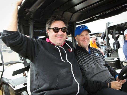Country music singer Vince Gill (left) and Jim Seabury.