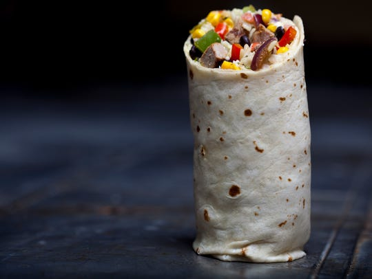 """Before being wrapped up, staff at Pancheros Mexican Grill use a spatula called """"Bob"""" to mix up burrito ingredients so that tastes and textures are evenly distributed in the finished product."""