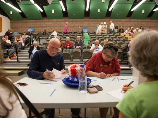 St. George residents meet at the Tonaquint Intermediate School to discuss and cast their caucus votes Tuesday, March 22, 2016.