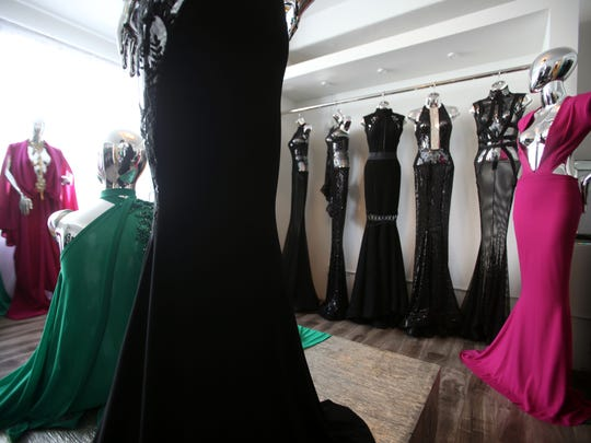 Gowns designed by Michael Costello at his showroom