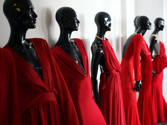 A collection of red gowns at Michael Costello showroom