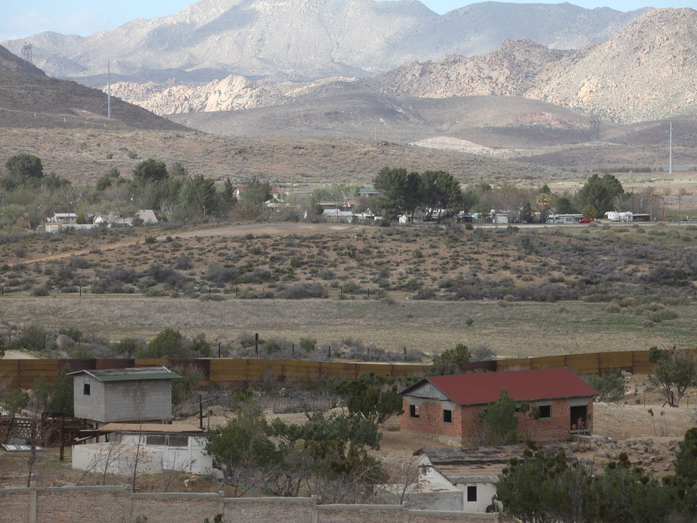 Homes and farms in Jacume, Mexico sit right along the U.S. border. Homes in Jacumba Hot Springs, California and other rural towns in the area are a little farther away.
