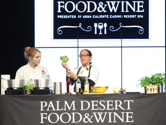 At far right, Celebrity Chef Valerie Gordon demonstrates how to prepare a Spring Salad at the James Beard Gourmet Luncheon during the Palm Desert Food and Wine charity event held at The Gardens on El Paseo on April 8, 2016.
