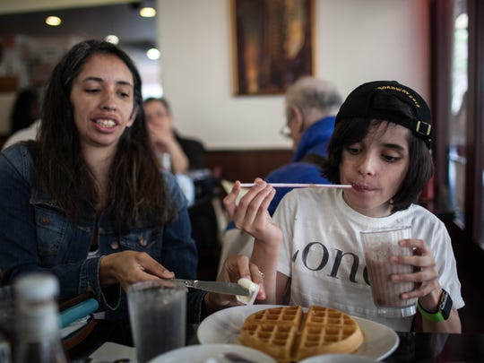 Oscar Williams eats breakfast with his mother, Zoe, at the Cosmic Diner on 8th Avenue on the afternoon before the Tony Awards held in Radio City Music Hall in New York City on Sunday, June 7, 2015.  LAUREN DeCICCA/for the FREE PRESS