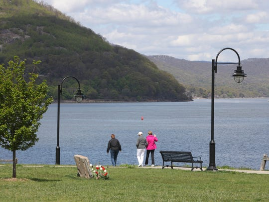 Walkers enjoy the Peekskill Southern Waterfront Park and Trailway along the Hudson River.