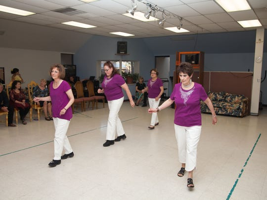 Boot Scootin line dancers from Ruidoso Downs Senior Center dance in unison.