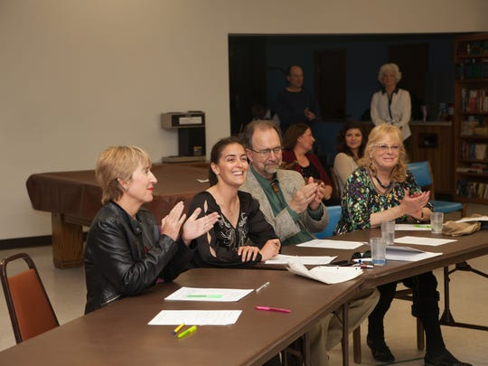 Judges Glenda Elser, Myranda Rodriguez Waldo, Dr. Michael and Delana Clemins applaud the participants.