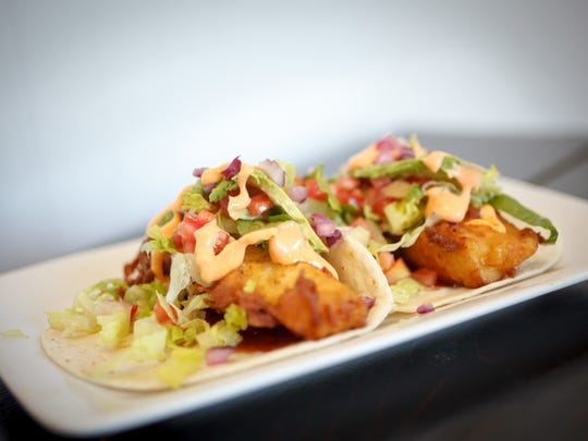 A pair of fish tacos from Shore Fire Grille in Surf City.