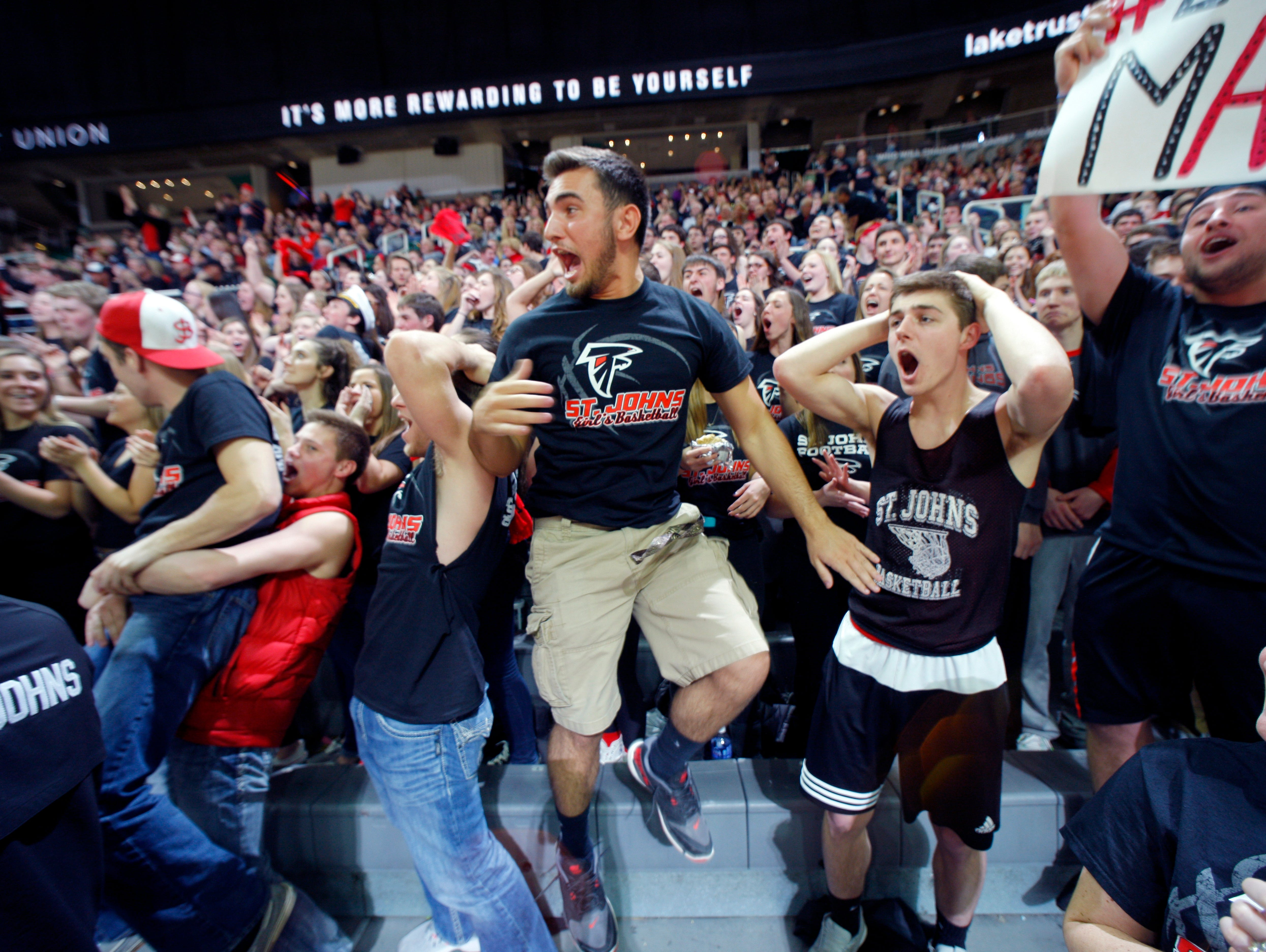 St. Johns fans cheer against Detroit King during their MHSAA Class A semifinal game Friday, March 18, 2016, at the Breslin Center in East Lansing. St. Johns fell 56-48.