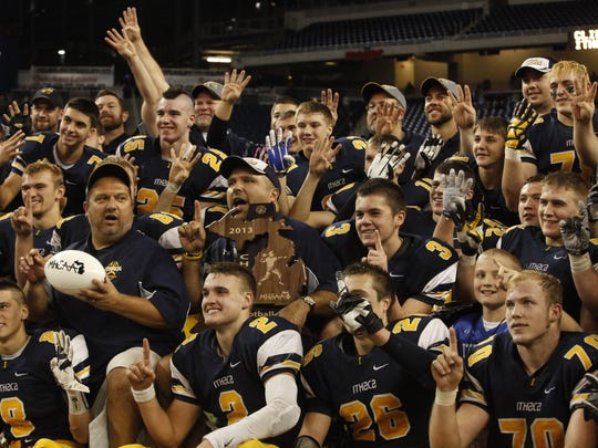Ithaca celebrates its fourth consecutive state championship at Ford Field on Nov. 29, 2013.