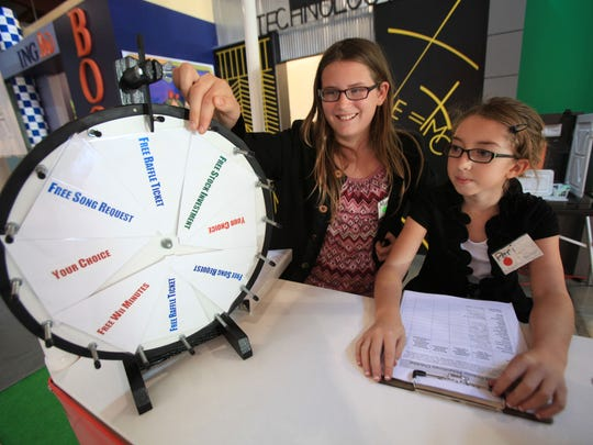Mary Scholz of Des Moines' west side, age 10 in this 2012 photo, left, and Peri Sagun, 10, of Urbandale, work in a philanthropy donation booth at JA BizTown in Des Moines Oct. 30. Sagun died Saturday at age 13 after an accident at her home.