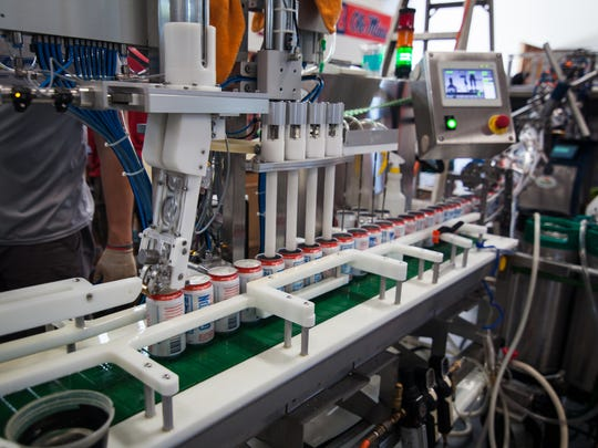 The Grayson Beer Company Beach Permit Blonde Ale canning line.