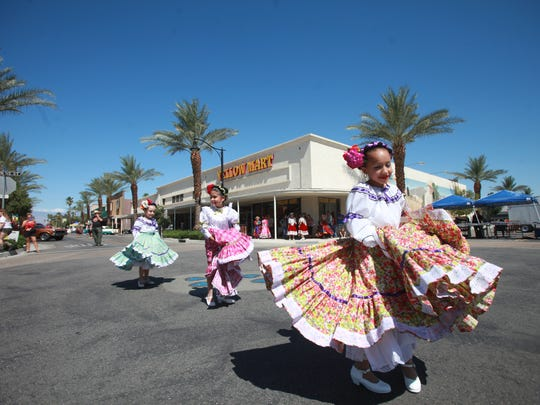 from far right, Isabel Inzunza, Anabel Tamias and Maria Jose Avi–a of Ballet Folklorico Sol Del Desierto, dance at the annual Indio Block Party on Saturday, May 21, 2016.
