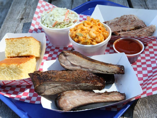 Roundup Texas Barbecue specialties that include ribs, brisket, cole slaw,  mac and cheese and cornbread.