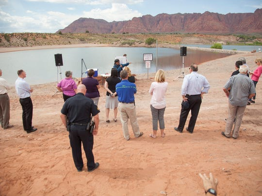 Ivins City officials and representatives from the Shivwits band of Paiutes discuss plans for the Ivins reservoir recreation area and cut a ribbon to commemorate the recent developments Thursday, May 26, 2016.
