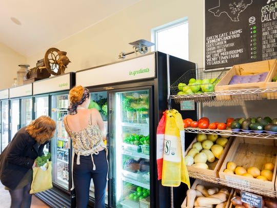 Shoppers at in.gredients in Austin, Texas, a zero-waste