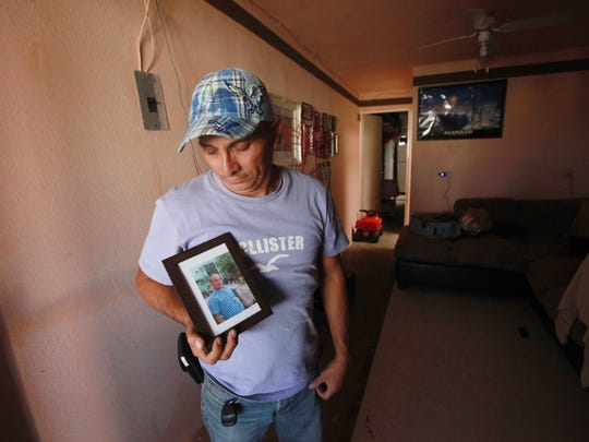 Ricardo Guzman Castaneda holds the photo of his brother-in-law Uriel Diaz, who died when the men attempted to cross into the U.S. in 2014. Diaz's body has not been recovered despite search attempts made soon after the incident. Castaneda also lost a brother.