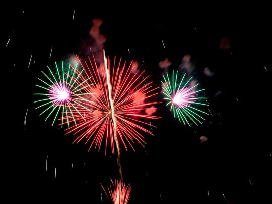 Fireworks light up the water above Lake Champlain during