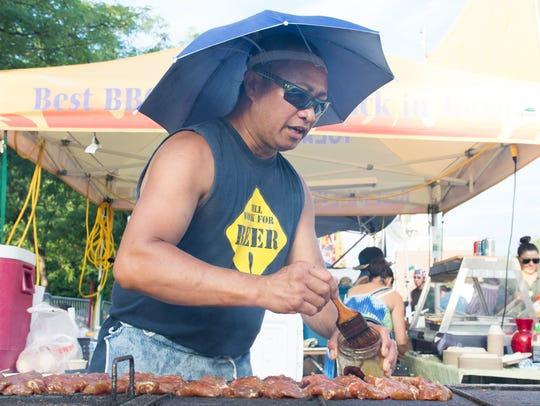 Tolen Forte of Coralville works the grill at the Yolanda's