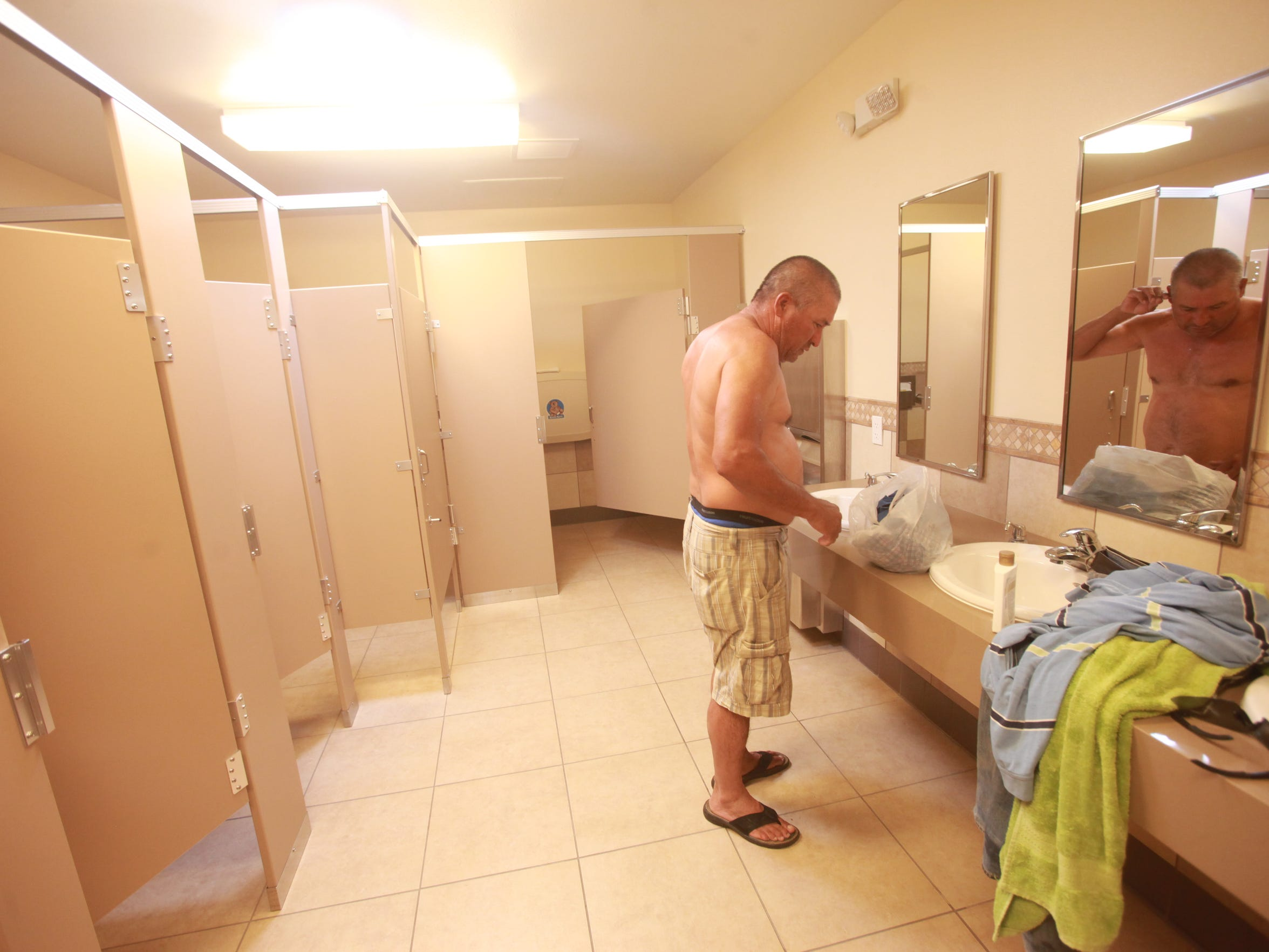 A migrant agricultural worker uses a public bathroom