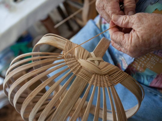 The hands of artist Leona Waddell making one of her