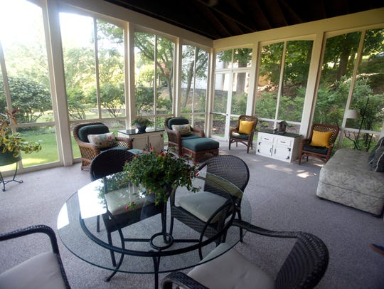The Jennetts' enclosed porch is a perfect haven for