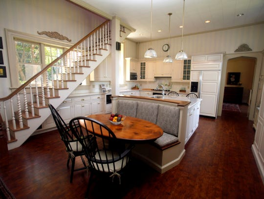 The staircase in the kitchen leads to the upstairs
