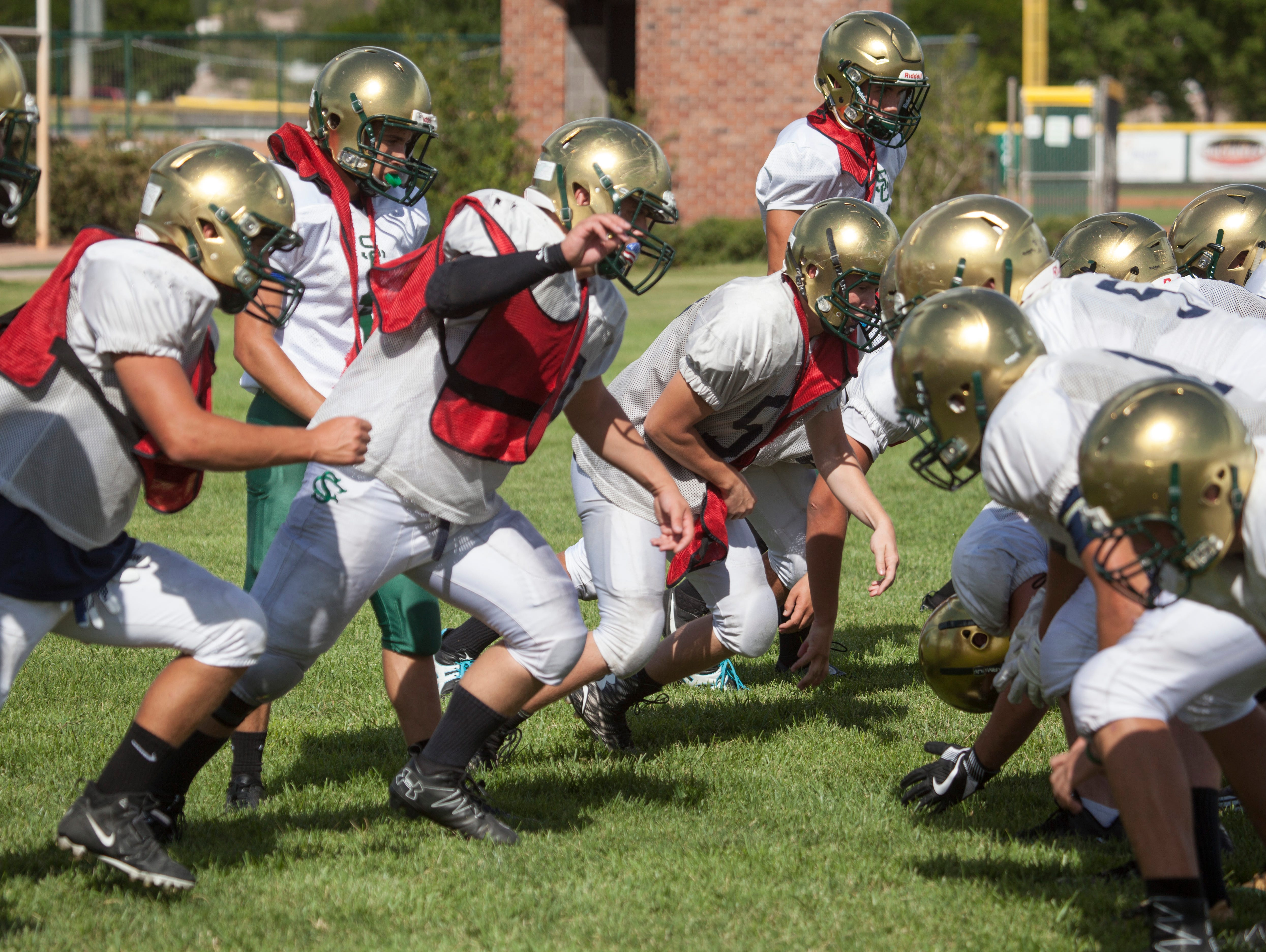 The Snow Canyon High School football team practices for their upcoming season Wednesday, August 10, 2016.