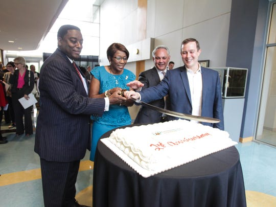 Caddo Parish Commissioner Lynn Cawthorne, Shreveport Mayor Ollie Tyler, Biomedical Research Foundation President and CEO John F. George Jr., M.D., and Shreveport City Councilman Jeff Everson cut the cake at EAP's second anniversary celebration and unveiling of the EAP Wall of Entrepreneurial Achievement.