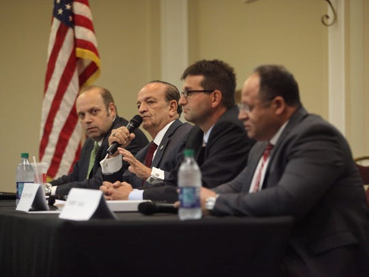 Candidates for New Castle County executive face off at a forum on Aug. 15. Thomas P. Gordon (second from left) and Matt Meyer (second from right) have been odds over their pasts.