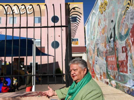 Maria Matos, president of the Latin American Community Center, sits outside of the center in Wilmington in 2014. She says Hispanic people fear what a Donald Trump presidency might bring.
