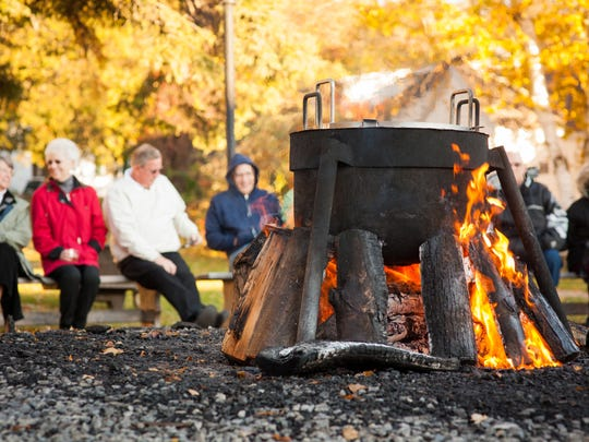 Fish is prepared in an outdoor kettle over an open fire during a fish boil at the Old Post Office Restaurant in Ephraim, Door County.